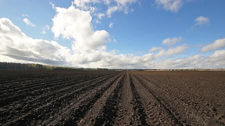furrow : Clouds over arable land close-up