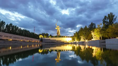 motherland : Russia, Volgograd - August 28, 2017: Sunset. The night is coming. Sculpture Motherland Calls! - compositional center of monument-ensemble to Heroes of Battle of Stalingrad on Mamayev Kurgan
