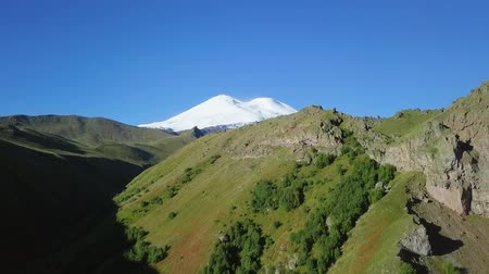 ágil : Elbrus from the north in the summer. Aerial view. Kabardino-Balkaria, Russia, From Dron, Unveiling shot Stock Footage