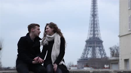 took : Happy couple having a good time in Paris at the Eiffel Tower Stock Footage