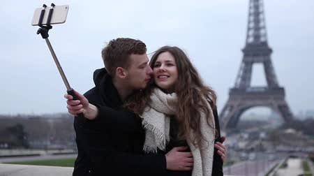 took : Happy couple taking selfie at the Eiffel Tower
