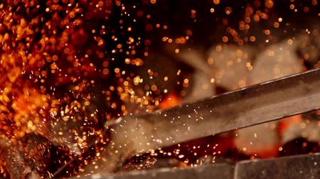 pyre : Sparks from coals in slow motion