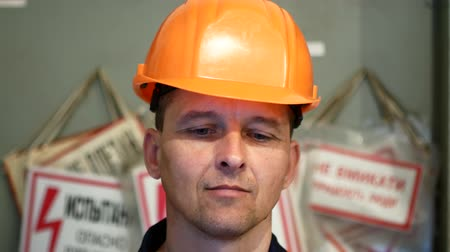 rescuer : Portrait of an experienced worker in the workplace. Handsome man in helmet looking at camera.