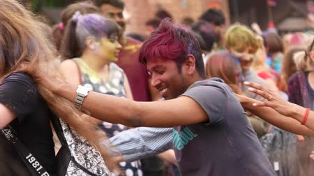 mob : Ukraine, Kharkov, 2018 People Celebrate Holi Colors Festival. Cool and modern open-air party. Celebration of Holi colors festival.