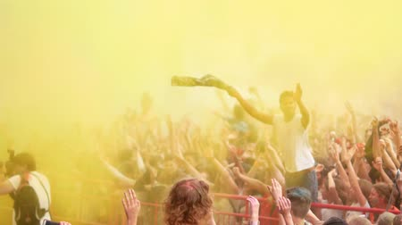 mob : Ukraine, Kharkov, May 2018 - Celebration of Holi colors festival. Happy people throwing colorful powder in the air at festival