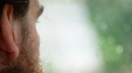 perspiration : handsome man with a beard, side view, close-up. Stock Footage
