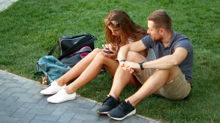teasing : happy couple having fun in university park . Concept of freedom youth lifestyle.