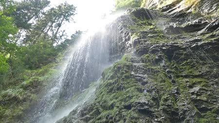 Beautiful waterfall in the Carpathians. Shooting from the bottom. 影像素材