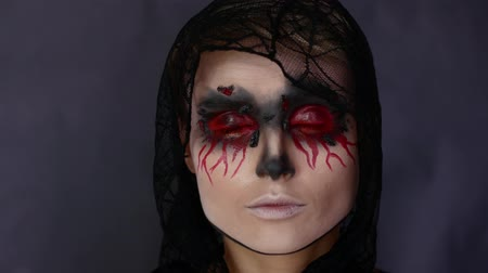hiding : Woman in make-up. Halloween image