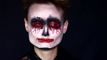 зловещий : Sad joker. Woman in Halloween Makeup