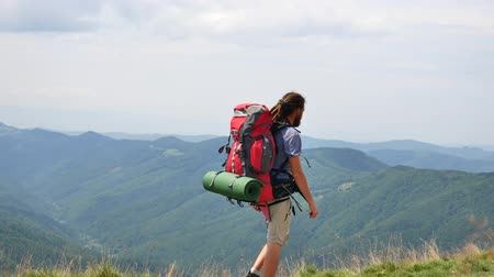 Hiking - hiker man on trek with backpack living healthy active lifestyle. Hike in mountain nature.