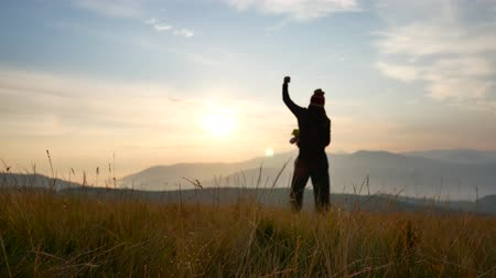 karpaty : Silhouette of man on the sunset. Freedom concept