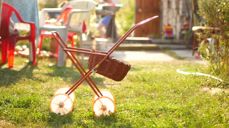 milestone : A toy carriage on a sunset background. Summer Cottage. Stock Footage