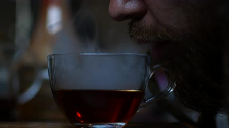 cigar : Smoke leaks from the cup. shooting in a cafe