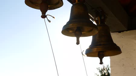 bell tower : Ringing bells in an orthodox temple. Sunset time Stock Footage