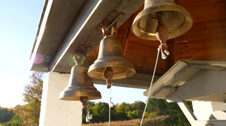 gréviste : Ringing bells in an orthodox temple. Sunset time Vidéos Libres De Droits