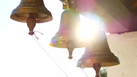 brazen : Ringing bells in an orthodox temple. Sunset time Stock Footage