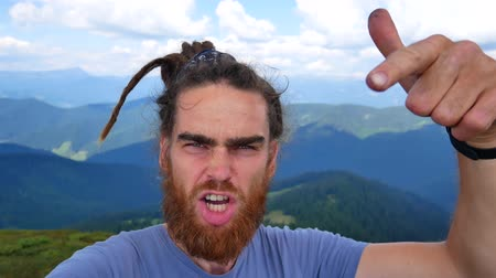 self portrait photography : Point of view of young man taking selfies wile on a hik , Man takes selfie on mountain top. Stock Footage