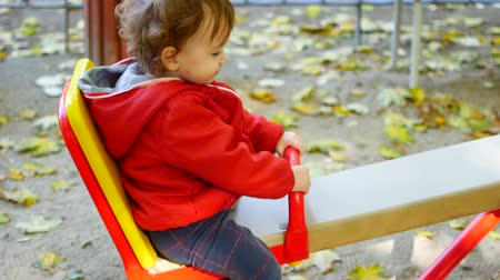 darling : Little curly girl is swinging up and down Stock Footage