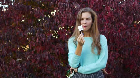 vacations cones : Woman Eating Ice Cream in Autumn Park.