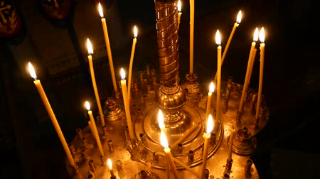 madona : Burning candle closeup on the background of other candles in the Christian Orthodox Church.
