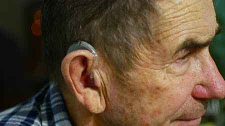 ayarlama : old man using hearing aids.