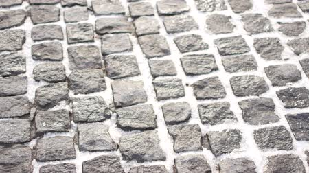 landscaping rocks : A sidewalk - known as a footpath, footway or pavement. Stock Footage