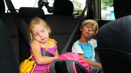 socialization : Boy and girl riding in the car. children fall asleep in the car.