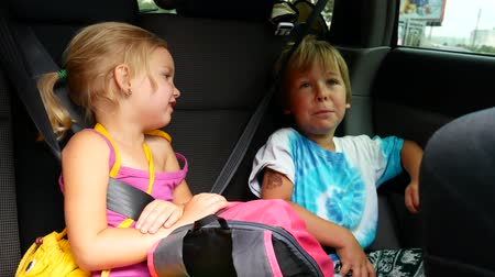 socialization : Boy and girl riding in the car.