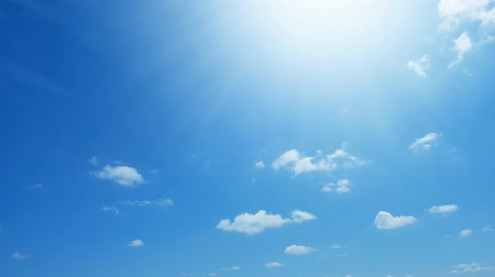 time laps : Time lapse of white clouds on blue sky. Stock Footage