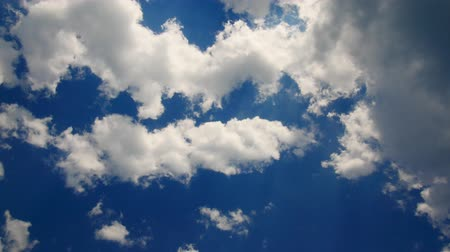 celestial : Time lapse of floating clouds against the blue sky. Sun through the clouds.
