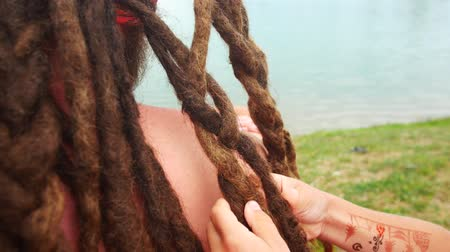 урод : Childs weave braids to his dad from his dreadlocks