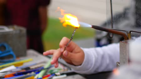 glass master : Child learns to blow glass, make glass figurines