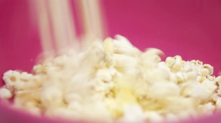crunchy : Popcorn falling in a plate.