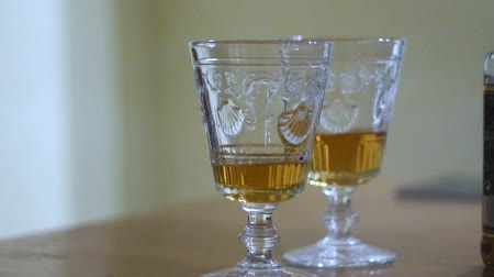 dois objetos : Two glasses with whiskey on the table. Stock Footage