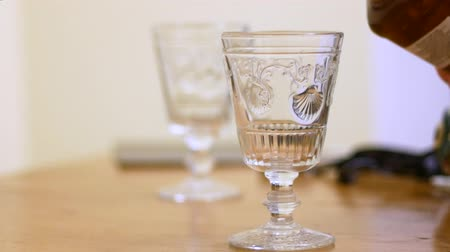 скотч : Two glasses with whiskey on the table. Стоковые видеозаписи