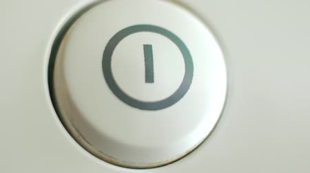switching : Pressing the on off button on any device.