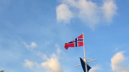 norvégia : Norway national flag in the sky.  Stock mozgókép