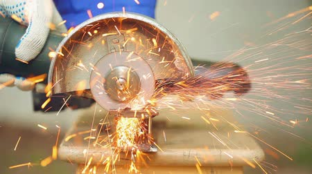 kutilství : Close-up view of cutting steel shape, huge amount of sparks. HD 1080p with ambient sound.