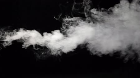 sobre o branco : Hight pressure of white smoke blowing out over the black background, HD 1080p Stock Footage