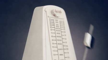 temp : Close-up view of music metronome with moving pendulum, ambient sound, HD 1080p, loop