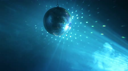 техно : Rotating disco ball with multicolor light effect and dense smoke, loop-ready, HD 1080p.