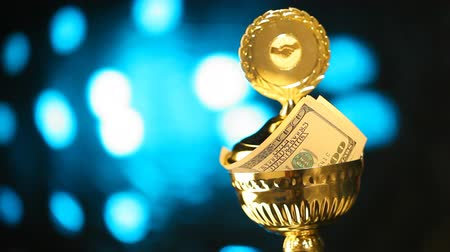 trofej : Super prize trophy with money, festive background Dostupné videozáznamy