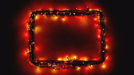 wire frame : Christmas lights frame on snow background with copy-space