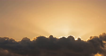 celestial : Sun rays over moving clouds time lapse