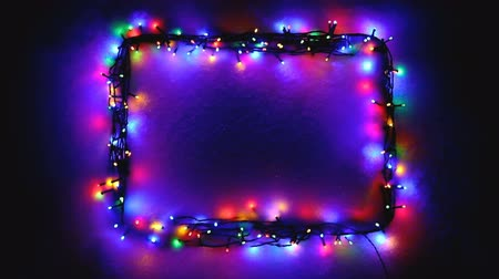 lights up : Christmas lights frame on snow background with copy-space