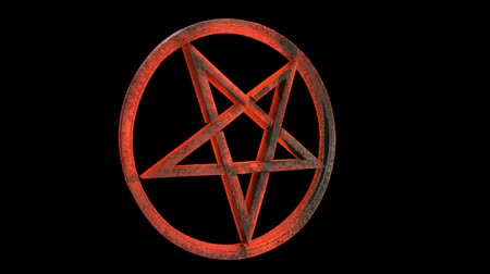 sembol : Loop of a rotating red and amber, translucent, sinister looking inverted pentagram in a circle, made out of volcanic glass, 3d with alpha matte Stok Video