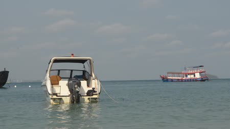 White speedboat park at beach. Motorboat travel on daylight.