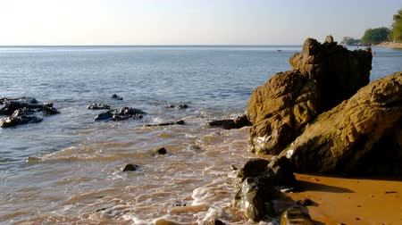 Stone rocks cliffs in water on background of Andaman Ocean in Thailand.  Natural landscape of Thailand. Peace and quiet.