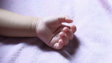 colic : Little hand of newborn baby.  care and birth concept.